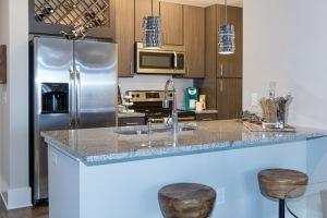 Coastal kitchen space with warm, circular lights