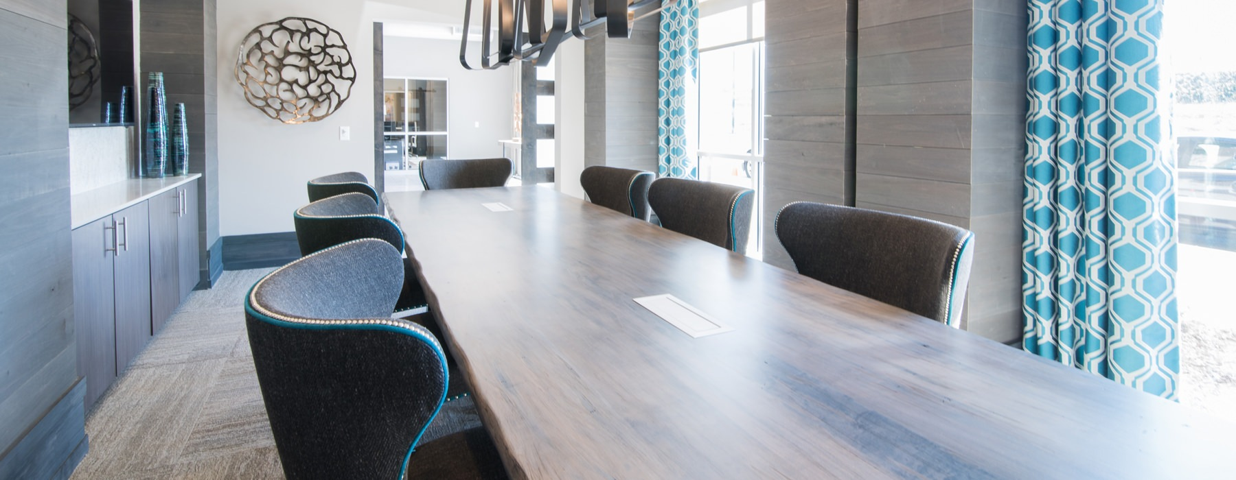 Large wooden conference table in modern styled room