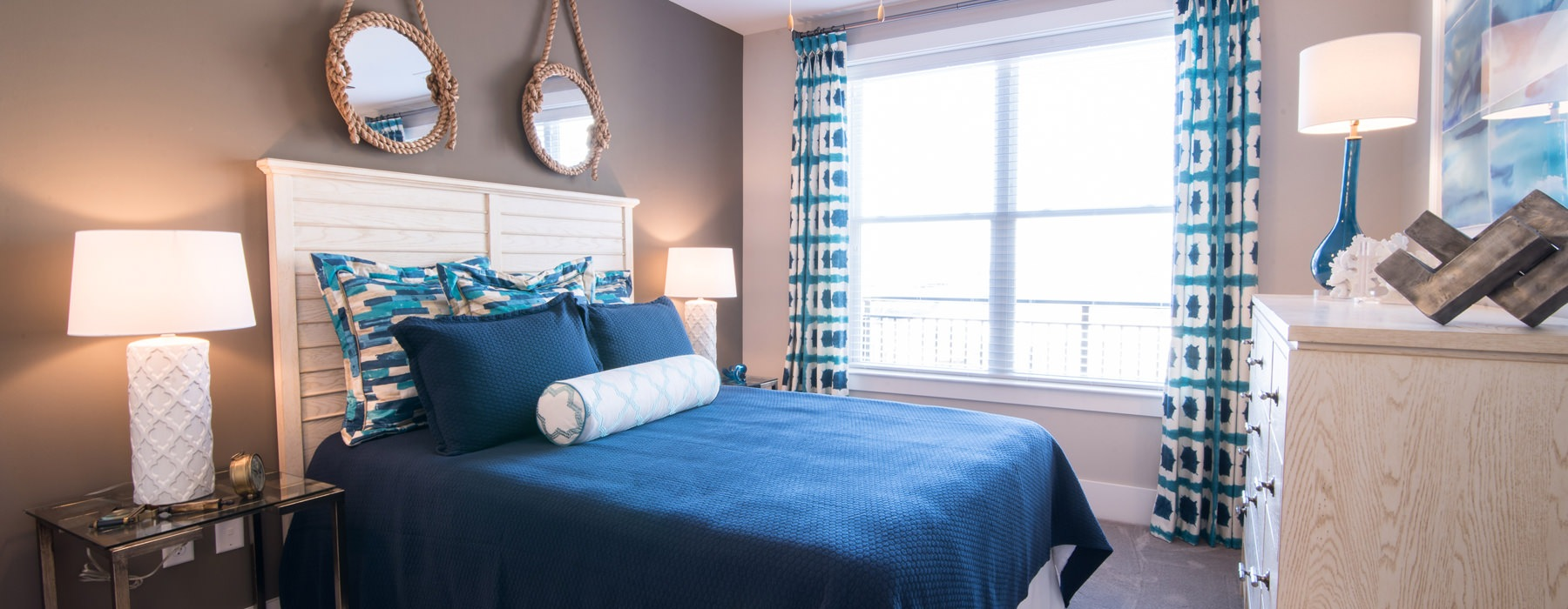 Coastal, cozy bedroom with large window